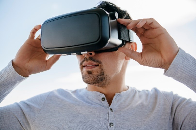man wearing a VR headset holding the screen
