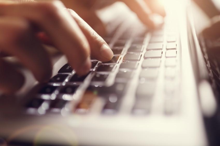 User typing on keyboard