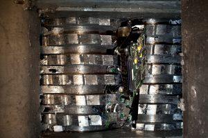Hard drive crusher shredder used for sensitive data destruction.